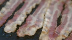 Sizzling Bacon on Griddle Stock Footage