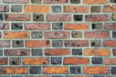 Stock Photo of parti-colored brick wall