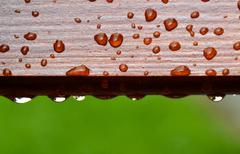 Stock Photo of drops of water on wood
