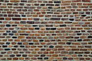 Stock Photo of old parti-colored brick wall