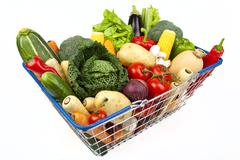 Shopping Basket full of Vegetables Stock Photos