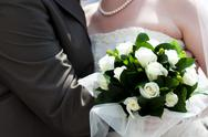 The bride and groom with a bouquet of flowers Stock Photos