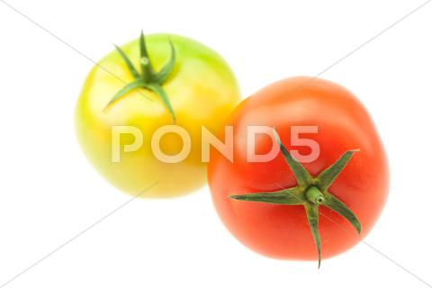 Stock photo of green and red tomatoes isolated on white