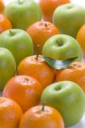 Clementine oranges and granny smith apples Stock Photos