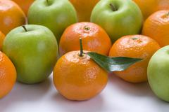 clementine oranges and granny smith apples - stock photo