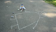 Stock Video Footage of Baby drawing his mother with chalk on asphalt