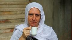 A Druze old senior woman in Isfiya drinks Yerba Mate Stock Footage