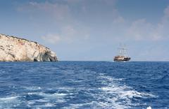 Caves and ship, Zakynthos island Stock Photos