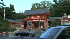Traffic in front of the entrance of the Yasaka Shrine Stock Footage