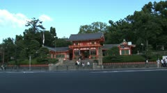 Traffic and ambulance in front of the entrance of the Yasaka Shrine Stock Footage