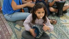 Young girl plays the Darbuka drum Stock Footage