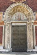 Entrance door of a romanic style church Stock Photos