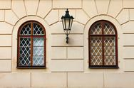 Stock Photo of Renaissance windows with iron street lamp