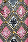 Wooden door with emblems - stock photo