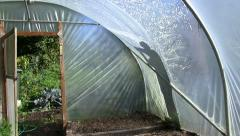 Cleaning the outside of a polytunnel Stock Footage