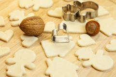 cut dough snowman, house, nuts, heart and forms for the cookies - stock photo