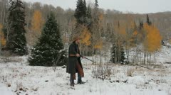 Cowboy Shooting a Shotgun in the snow Stock Footage
