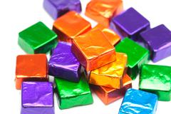 Candies in shiny wrappers isolated on white Stock Photos