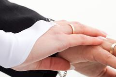 hands of the bride and groom with the rings - stock photo