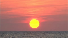 Sun going down to the Sea till it touch the Verizon Line HD Stock Footage