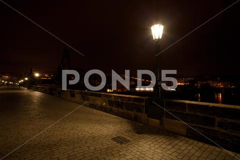 Stock photo of a beautiful night view of the charles bridge in prague