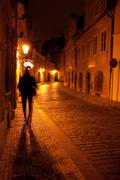 a beautiful night view of the street and the shadow of a man in prague - stock photo