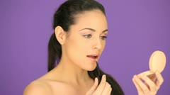 Beautiful woman applying lipgloss Stock Footage