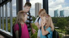 Cute kids in a modern school building smile for camera Stock Footage
