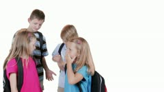 Cute school kids stop talking and smile for camera Stock Footage