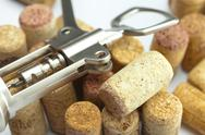 Background of the mountains  of wine corks and a corkscrew Stock Photos