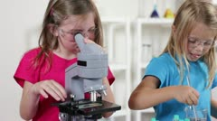 Young scientist looking in a microscope Stock Footage