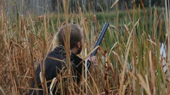 Duck hunter takes aim. Stock Footage