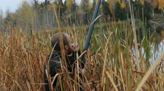 Duck call in the reeds Stock Footage
