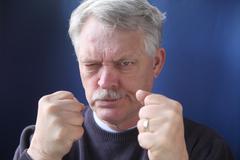 Hostile and combative senior man.jpg Stock Photos