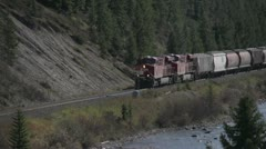 Railroad, Morants curve grain train, locomotives leading long shot Stock Footage