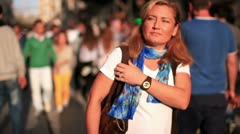 Attractive beautiful blonde woman walking very crowded street, slow motion Stock Footage