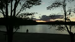 Couple kiss walden pond sunset Stock Footage