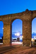evora aqueduct by night - stock photo