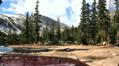 Driving a Jeep off road on a very bumpy road in Rocky Mountains Stock Footage