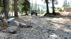 Jeep on a very rough and rocky road in beautiful Rocky Mountains Stock Footage
