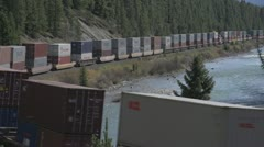Railroad, Morants curve container train medium shot Stock Footage