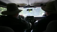 2 men driving in the beautiful Rocky Mountains Stock Footage