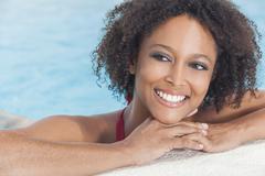 sexy african american woman girl in swimming pool - stock photo