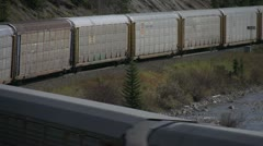 Railroad, Morants curve, auto carriers train long lens Stock Footage