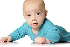 Beautiful baby boy on white background Stock Photos