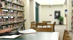 Student Laptop Library Pan Stock Footage