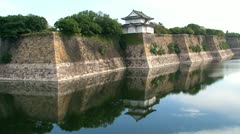 Osaka castle guard house water reflection Stock Footage