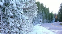 Pan of truck coming down a snowy road in the Beautiful Rocky Mountains Stock Footage