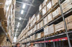 Rows of shelves with boxes in modern warehouse Stock Photos
