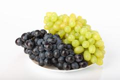 a plate with grapes - stock photo